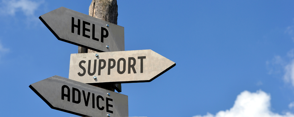 "signs with the words, ""help,"" ""support"" and ""advice"""