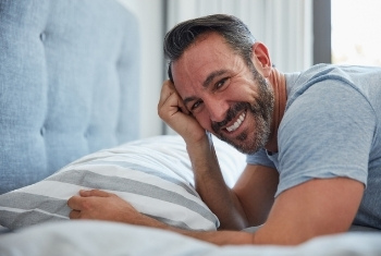 smiling man on bed