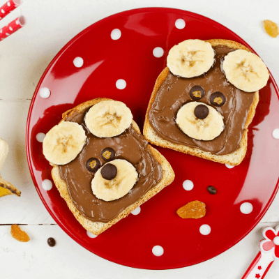 chocolate and bananas on toast in the shape of bear faces